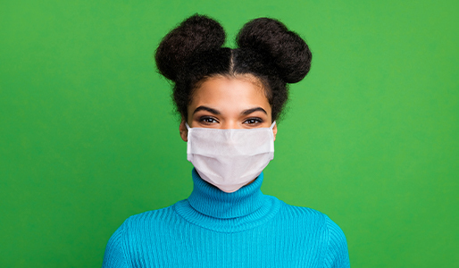 Woman wearing mask looking for coronavirus test kits
