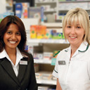 Two female pharmacists at a Superdrug store