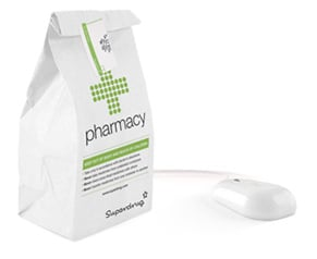 Superdrug pharmacy bag next to a computer mouse